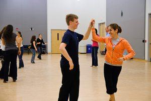 Karoline Kasiorowski, a senior Molecular and Cell Biology and Anthropology major, dances with Scott Loescher, a senior Biology major during the UConn Ballroom Club's meeting at the Rome Ballroom.